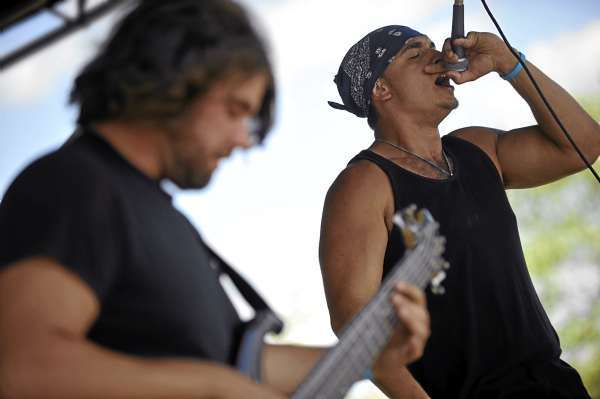 Andrew Downey, right, guitarist  Josh Bernier and other members of the  Orono-based band Restless Groove  pump up the funk and hip-hop   during their gig on Stage C on Bangor's waterfront Friday afternoon, August 13, 2010. (Bangor Daily News/John Clarke Russ)