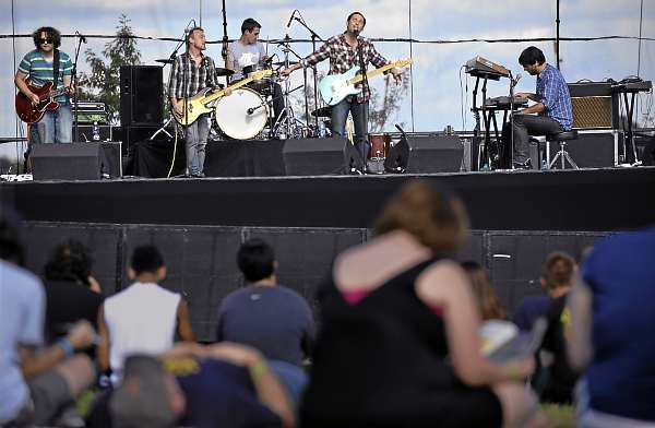 Members of the Portland, ME-based band Good Night Process perform on Bangor's waterfront as part of  Friday's KahBang Festival line-up. (Bangor Daily News/John Clarke Russ)