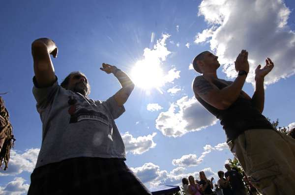 Ron Warren, left, of Bangor and others rock out to Orono-based band Restless Groove during their gig on Stage C on Bangor's waterfront Friday afternoon, August 13, 2010. (Bangor Daily News/John Clarke Russ)