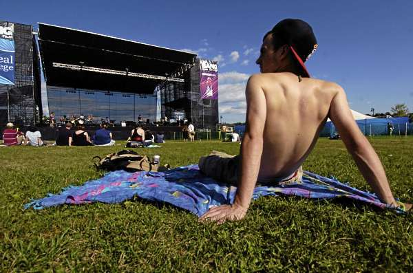 Andy Brown, 18 of Princeton takes in the scene  as the Portland-based band Good Night Process performs on Bangor's waterfront as part of Friday's KahBang Festival line-up. He said he and his girlfriend Hope Howard of Woodland arrived for the festival on Friday and are also checking out Saturday's performances. (Bangor Daily News/John Clarke Russ)