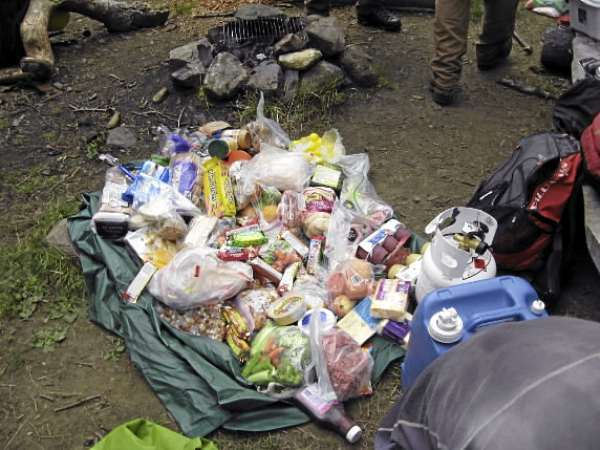 It takes a lot of food to feed 5 hungry trail workers like those on the Maine Trail Crew. This pile will last five days and four nights.