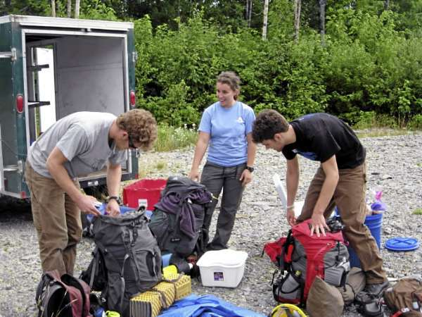 Three members of the Maine Trail Crew pack up for a five day/four night work trip on the Appalachian Trail north of Monson. Left to right, Lucas Harris, Taylor McDonnell, and Lucas' brother Nathan. Lucas Harris and McDonnell are Student Conservation Association volunteers, while Nathan Harris is volunteering for a week to help build trail projects with his brother.