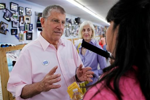 In this Friday, Aug. 13, 2010 photo, independent gubernatorial candidate Eliot Cutler campaigns at the Topsham Fair in Topsham, Maine. The candidate's wife, Melanie Cutler, is seen in background. (AP Photo/Robert F. Bukaty)