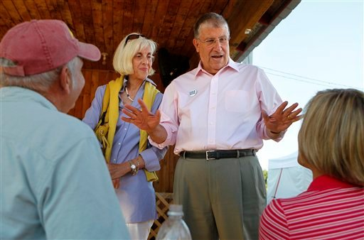 In this Friday, Aug. 13, 2010 photo, independent gubernatorial candidate Eliot Cutler campaigns with his wife, Melanie Cutler, at the Topsham Fair in Topsham, Maine. (AP Photo/Robert F. Bukaty)
