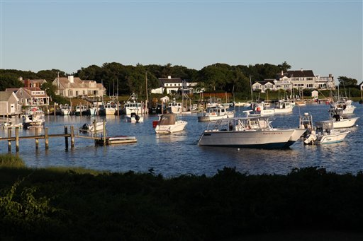 In this July 2, 2010 photo, privately owned boats are moored in Wychmere Harbor in Harwich, Mass. Ground fishing has virtually disappeared in this small port, and new fishing rules enacted in May have fishermen at New England's major ports worried their historic fishing communities could fade away as well. (AP Photo/Julia Cumes)