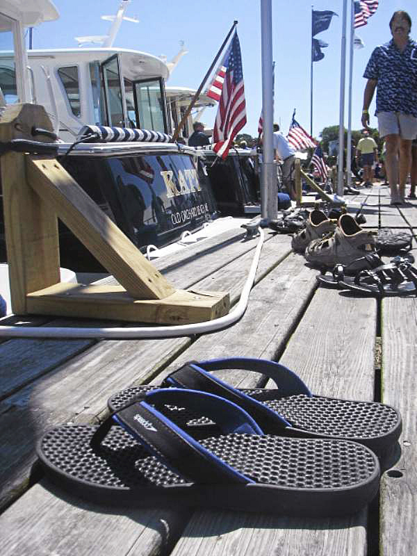 Shoes lie on a float Sunday at Rockland's waterfront, left by visitors to the annual Maine Boats, Homes & Harbors Show as they boarded boats to get better looks. Organizers of the show estimated that approximately 10 to 15 percent more people visited the show this year than in 2009, when it attracted 9,000 people to downtown Rockland. (Bangor Daily News Photo by Bill Trotter)