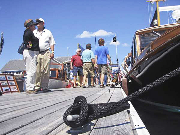 Attendees at the Maine Boats, Homes & Harbors Show walk past display boats at Rockland's watefront on Sunday afternoon. Organizers of the show estimated that approximately 10 to 15 percent more people visited the show this year than in 2009, when it attracted 9,000 people to downtown Rockland. (Bangor Daily News Photo by Bill Trotter)