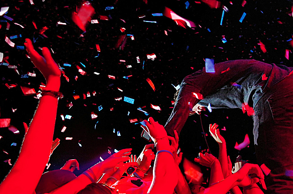 Damian Kulash (right) of the band OK Go gets some love from the crowd while performing at KahBang on the Bangor Waterfront on Saturday, Aug. 14, 2010. More than 5,000 attended the musical performances throughout the weekend which ended the weeklong festival of art, music and film. (Bangor Daily News/Bridget Brown)