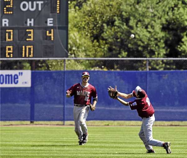 District THree second baseman Seth Freudenberger, (2), draws a bead on the ball as teammate Josiah Hartley backs up the play on a fly ball in the seventh inning of their game versus Team Canada at Mansfield Stadium, Bangor, Sunday, August 15, 2010.Bangor Daily News/Michael C. York