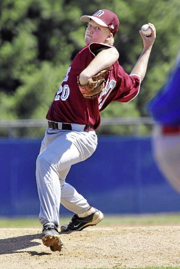 District Three pitcher Jesse Wood delivers to the plate in the first inning of their game versus Team Canada at Mansfield Stadium, Bangor , Sunday, August 15, 2010.Bangor Daily News/Michael C. York