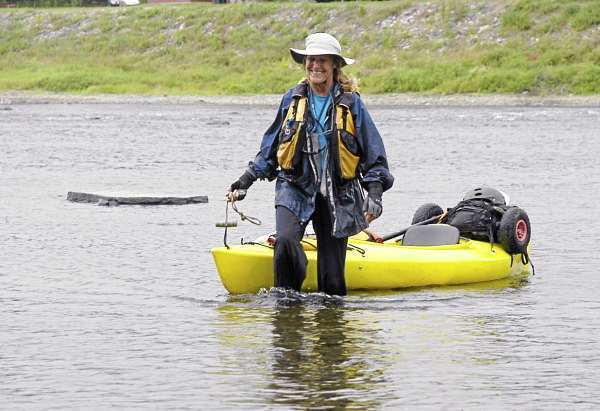 Cathy Mumford is all smiles as she walks off the St. John River in Fort Kent 58 days after starting the Northern Forest Canoe Trail in Old Forge, New York. Mumford became the first woman to solo the 740-mile canoe route through New York, Vermont, Canada and Maine. (Photo by Julia Bayly)