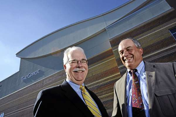 John Rohman, left, WBRC chairman and  Stephen Rich, left, WBRC President/CEO in front of the the Gracie Theater at Husson University Campus August 17, 2010. The Gracie Theater is one of the many large projects the Bangor-based architectural and engineering firm has undertaken in its hundred-plus year history. (Bangor Daily News/John Clarke Russ)