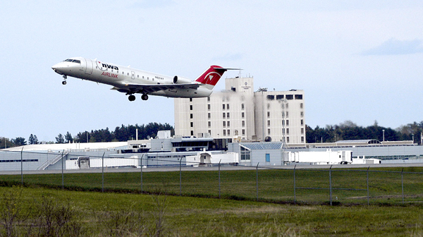 A passenger jet leaves the runway at Bangor International Airport on Wednesday. Recently there have been an increasing number of flights diverted to BIA with passengers on the no-fly list.  (AP Photo/Bob DeLong)