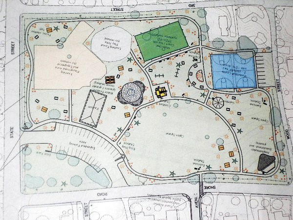 An architects drawing depicts a concept plan for a community park on the site of the Knowlton School in Ellsworth. The school, which will be vacant this year as its students attend classes in the new Ellsworth Elementary and Middle School, would be demolished to provide room for the park which could include relocated basketball courts, a splash pond, an amphitheater, picnic areas and walking paths with exercise stations. Under the proposal, the existing parking area and playground would remain on the site. BANGOR DAILY NEWS PHOTO BY RICH HEWITT