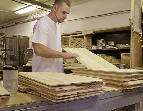 Mike Brown,Mt View Corr.Fac., Charleston, Monday August 17, 2010,  looks over cabinet doors he is finishing for schoolroom storage at SAD 4 in Guilford. michael c. york/bangor daily news