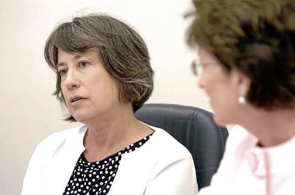 Sheila Bair, Chairman of the Federal Deposit Insurance Corporation or FDIC, speaks to reporters next to Senator Susan Collins in Bangor on Wednesday, Aug. 18, 2010. (Bangor Daily News/Bridget Brown)