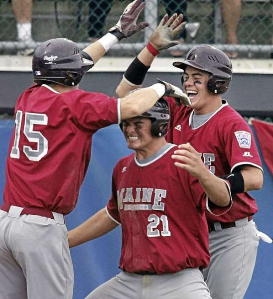 District three players Nic Cota, (right), Anthony Capuano, (21), and Dylan Morris, (15), celebrate their  2 out rally in the third inning of their game versus South Vineland , NJ, at Mansfield Stadium, Bangor, Wed., August 19, 2010. Bangor Daily News/Michael C. York