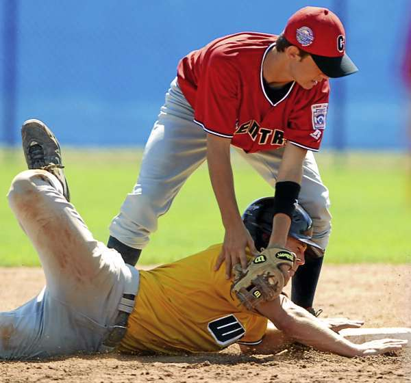 BANGOR, ME -- AUGUST 19, 2010 -- US West's (Manhattan Beach, CA) Ryan Erickson is safe at second under the tag of Central's (Holmes County, OH) Ryan Troyer during an attempted pick off in the 6th inning of the Thursday morning Senior League World Series game at Mansfield Stadium.  West won 6-3 in 9 innings. PHOTO BY LINDA COAN O'KRESIK