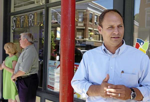 Jason Levesque of Auburn who is running for the U.S. Congressional seat in the 2nd district, talks reporters in downtown Bangor on Thursday, Aug. 19, 2010. Levesque was doing a walking tour of area businesses with Senator Olympia Snowe. (Bangor Daily News/Bridget Brown)