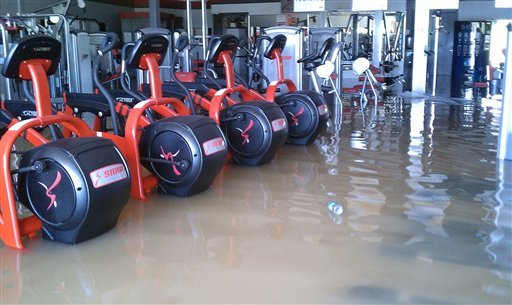This photo taken May 2, 2010, shows the flooded Snap Fitness Gym in Ashland City, Tenn., which was shut down for three months.  (AP Photo/Jay Hennessey) NO SALES