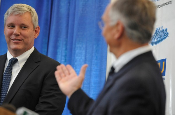 University of Maine President Robert Kennedy, right, introduces Steve Abbott, left, as the university's interim athletic director, during Friday afternoon's press conference at Alfond Family Lounge on U Maine's Orono campus. (Bangor Daily News/John Clarke Russ)