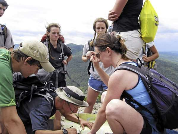 Leah Titcomb, right, an educator with the Chewonki foundation, instructs high school students in the Maine Youth Wilderness Leadership Program in map reading skills near the top of North Traveler Mountain in Baxter State Park. BRAD VILES 8/21/10