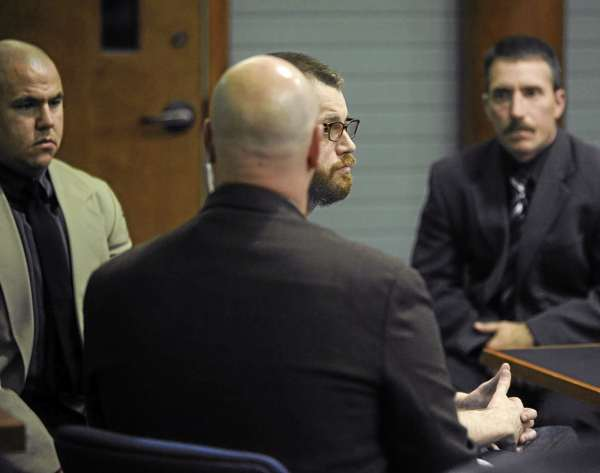 Michael Chasse (center, partially obscured) sits in the court room surrounded by security personell at Knox County Superior Court.  Chasse was found guilty on all eleven charges by the jury. (Bangor Daily News/Gabor Degre)