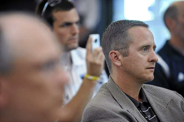 Blake James, right, and others listened to Steve Abbott after University of Maine President Robert Kennedy (not pictured) introduced Abbott Friday, August 20 , 2010 as the interim athletic director, succeeding the departing James.(Bangor Daily News/John Clarke Russ)