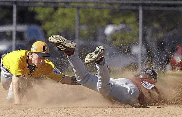 District Three's Wyatt Frost, (9),  slides head-first into second base avoiding the tag of Team West's Trent Hammond ,(14), in the second inning of their semi-final game of the Senior League World Series  at Mansfield Stadium , Bangor, Friday, August 20, 2010. Bangor Daily News/Michael C. York