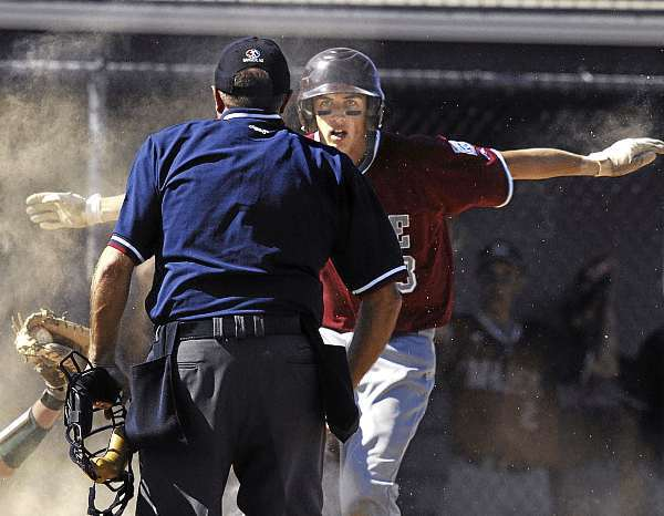 District Three's Christian Corneil, (13), stares at the home-plate Umpire looking for the call as he is out at home in the third inning of their  semi-final game at the Senior League World Series versus Team West at Mansfield Stadium , Bangor, Friday, August 20, 2010. Bangor Daily News/Michael C. York