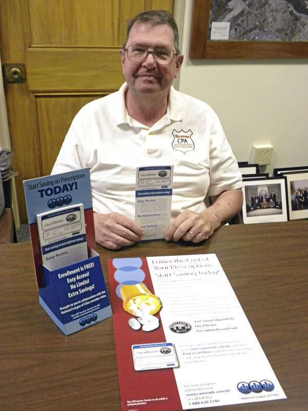 Brewer City Councilor Manley DeBeck has worked to bring free prescription discount cards to residents. The cards are offered to member communities in the National League of Cities and are available in Brewer at City Hall, the public safety building, library, and Brewer Auditorium. The cards are accepted at all of the city's pharmacies and at major pharmacy chains nationwide. (Bangor Daily News Photo by Nok-Noi Ricker)
