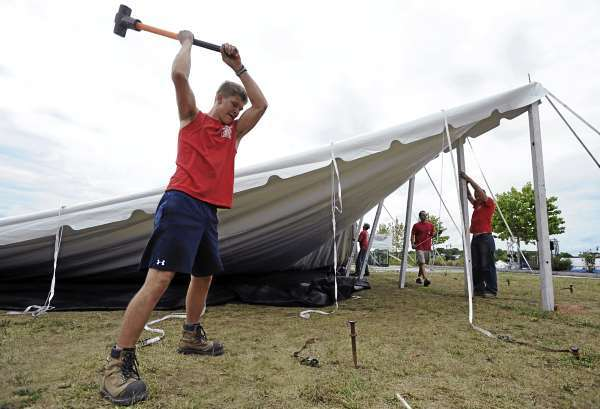 Paul Ussher (cq) a worker with Commercial Tent of New Brunswick Canada drives a tent stake on what will become the Penobscot Stage tent of the American Folk Festival along the Bangor waterfront on Monday, August 23, 2010. The American Folk Festival kicks off on Friday, August 27 at 6:30 p.m. with the Pride of Maine Black Bear Marching Band. (Bangor Daily News/Kevin Bennett)