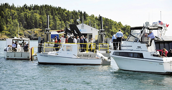 VIP's gather aboard the Energy Tide 2, in Coobscook Bay on Tuesday, August 24, 2010. Ocean Renewable Power Company launched the 60kW tidal turbine in March and was showing it off after a recent re-deploy and upgrade. The turbine provides power to Coast Guard Station Eastport's 41-foot unitlity boat and is the largest ocean tidal generator in the United States. (Bangor Daily News/Kevin Bennett)