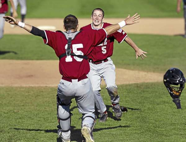 District Three closing pitcher Luke Hetterman, (5), and catcher Dylan Morris, (15), celebrate the moment as they win the semi-final in the Senior League World Series versus Team West at Mansfield Stadium , Bangor, Friday, August 20, 2010. Bangor Daily News/Michael C. York