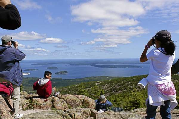Hawk-watchers stand at the top of Cadillac Mountain on Tuesday, Aug. 25, 2010 to count and identify the migrating birds. (Bangor Daily News Photo by Aislinn Sarnacki)