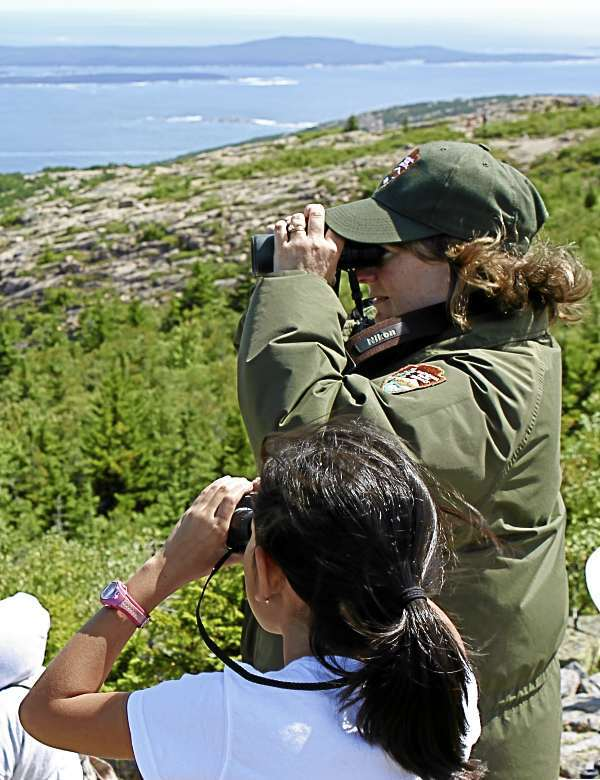 Acadia National Park Ranger Angi King Johnston and a young hawk-watcher stand on Cadillac Mountain and look east as they count and indentify migrating birds Tuesday, Aug. 24, 2010. (Bangor Daily News Photo by Aislinn Sarnacki)