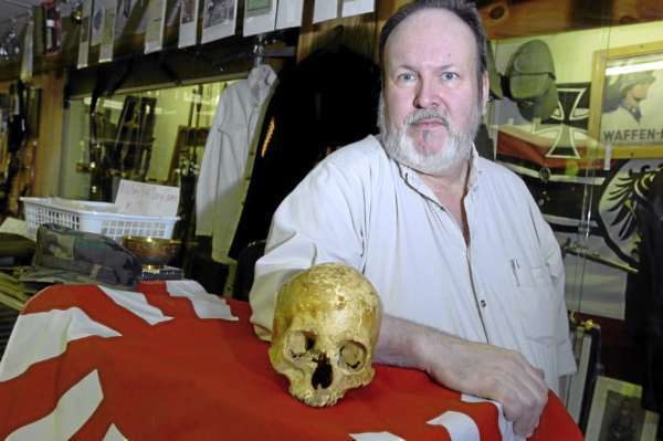 Ralph McLeod, owner of Buyers Guns in Holden, recently purchased a box of items from World War II, including a Japanese skull.  McLeod is working on returning it to the Japanese government. (PHOTO BY LINDA COAN O'KRESIK)