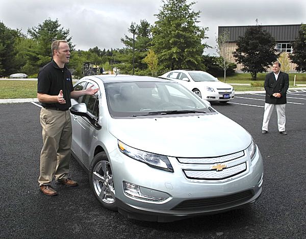 August 26, 2010 Stephen Marlin (left), a driver relationship manager with General Motors, discusses the 2011 Chevrolet Volt during a media event held at Eastern Maine Community College in Bangor. Lokking on is Bob Quirk of Quirk Auto Park. The Maine Chevrolet Dealers Association sponsored the car's appearance in Bangor for the American Folk Festival, during which the Volt will be displayed at Bangor Waterfront Park. (NEWS Photo by Brian Swartz)