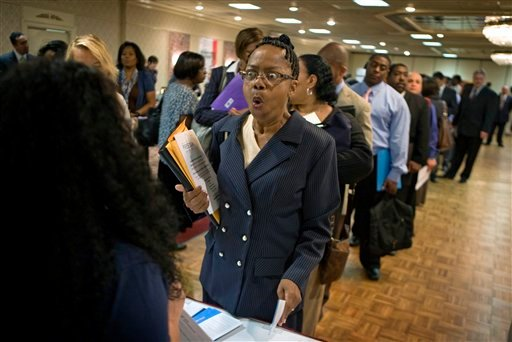 Dabura Karriem, 60, of Bloomfield, N.J., reacts upon hearing there is a job available for exactly what she's looking for as a file clerk at a bank, while attending a career fair in Newark, N.J., Tuesday, Aug. 24, 2010. Karriem's unemployment benefits have expired after being laid off two years ago, the first time she's been unemployed in 38 years. The government on Friday Aug. 27, 2010 is about to confirm what many people have felt for some time: The economy barely has a pulse.  Many analysts say the uncertainty surrounding the economy is holding back consumers from spending and companies from investing and hiring. (AP Photo/David Goldman)
