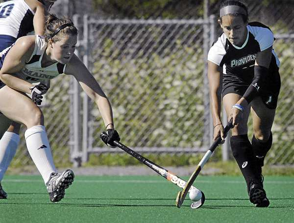 Maine's Alexa Binnendijk, (10), and Providence's Nicole Fernandez, (15), battle for control of the ball near mid-field in the first period of play in their game at Umaine Friday, August 27, 2010. Bangor Daily News/Michael C. York