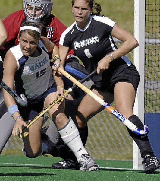 Maine's Zoe Adkins, (15),  gets knocked around in front of her goalkeeper Brittany Fleck, (77), by Providence's Hillary Anderson, (6), in the first period of play at UMaine Friday, August 27, 2010. Bangor Daily News/Michael C. York