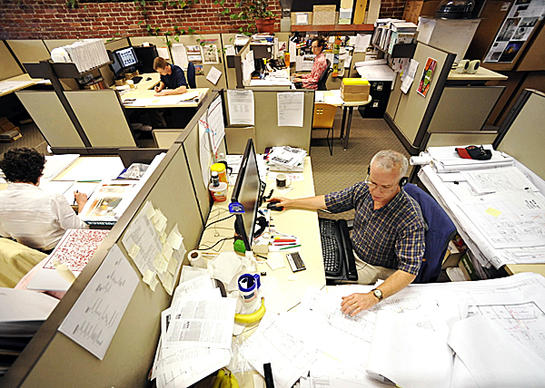 CAD technician Ralph Libby (foreground right) works on floor plan for MDI Biological Laboratories--one of many projects designed at WBRC Architects/ Engineer's Bangor office. Working nearby are architect Jill Simpson (top right of Bangor, archtectural intern Shane Dunn (top left) of Orono, and architect Shirley Holt (lower left) of Old Orchard Beach. Photographed August 17, 2010. (Bangor Daily News/ John Clarke Russ)