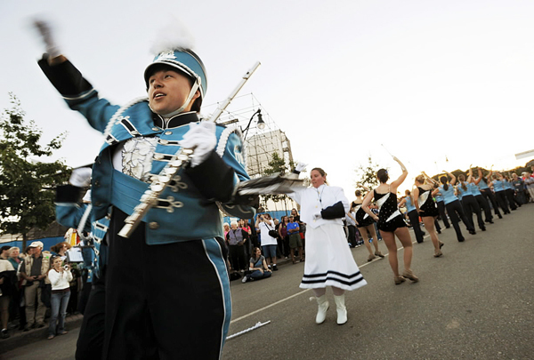 Rosie Tanabe flute player with the Pride of Maine Black Bear Marching Band dances in the street as they play the Beer Barrell Polka during the opening of the American Folk Festival on Friday, August 27, 2010. BANGOR DAILY NEWS PHOTO BY KEVIN BENNETT