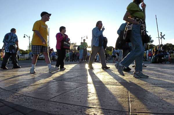 Festival goers make their way to the parade route on opening night of the American Folk Festival on the Bangor Waterfront on Friday, Aug. 27, 2010. (Bangor Daily News/Bridget Brown)