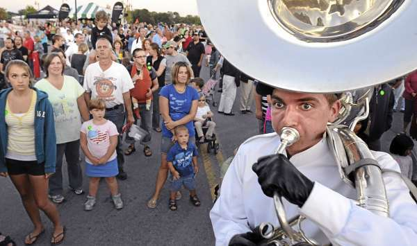Pride of Maine Black Bear Marching Band mamber Garrett Artaman (right) a Suzaphone player playes the Maine Stein Song as the band lead the opening parade of the 2010 American Folk Festival in Bangor Friday evening. (Bangor Daily News/Gabor Degre)