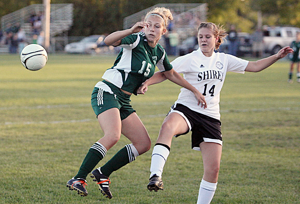 Roxy Pelletier, left, of Fort Kent uses her hip to deflect the ball away from Houlton's Taylor Bailey during Friday night's soccer game at Houlton.