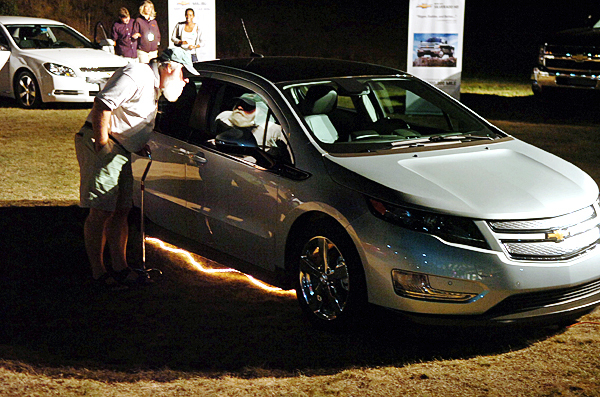 A man looks at a newly unveiled Chevy Volt at the American Folk Festival on the Bangor Waterfront on Friday, Aug. 27, 2010. (Bangor Daily News/Bridget Brown)