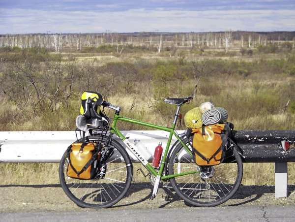 A touring bike carrying both front and rear panniers. A bicycle equipped to carry panniers can take a cyclist on a journey across the U.S. or simply on the morning commute to work. (photo by Levi Bridges)