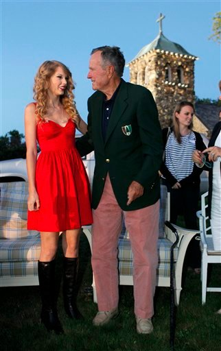 Taylor Swift meets former President George H. W. Bush at the premiere of her new video, &quotMine,&quot in Kennebunkport, Maine, Friday, Aug. 27, 2010. (AP Photo/Robert F. Bukaty)