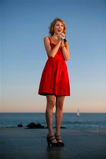 Taylor Swift acknowledges the crowd at the premiere of her new video, &quotMine,&quot in Kennebunkport, Maine, Friday, Aug. 27, 2010. (AP Photo/Robert F. Bukaty)